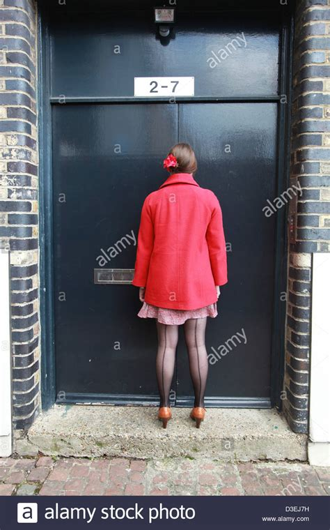 Woman, back view, wearing black seamed stockings Stock