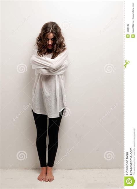 Young Insane Woman With Straitjacket Standing Stock Image
